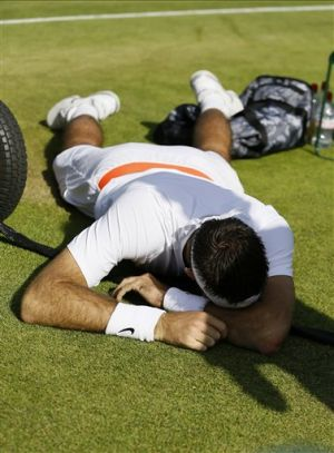 Del Potro concerned about knee, ankle injuries